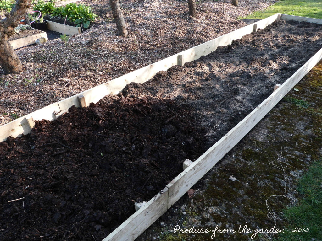 cutting garden border, layers of top soil and compost